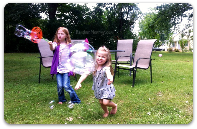 My favorite pic of B.  She is really, really determined to get that bubble, lol.